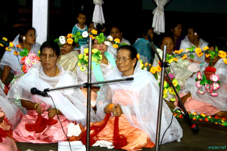 Devotees sing devotional songs at Mandop on occasion of Jhulon Festival at Khuyathong, Imphal :: July 30 2012
